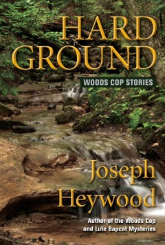 Hard ground : Woods Cop stories / Joseph Heywood. - Joseph Heywood.