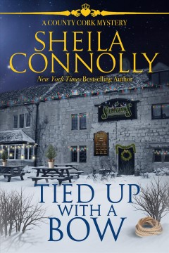 Tied up with a bow /  Sheila Connolly.
